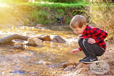 Brothers camping by creek